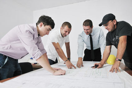 Team of construction industry professionals review building plans for cellulose insulation